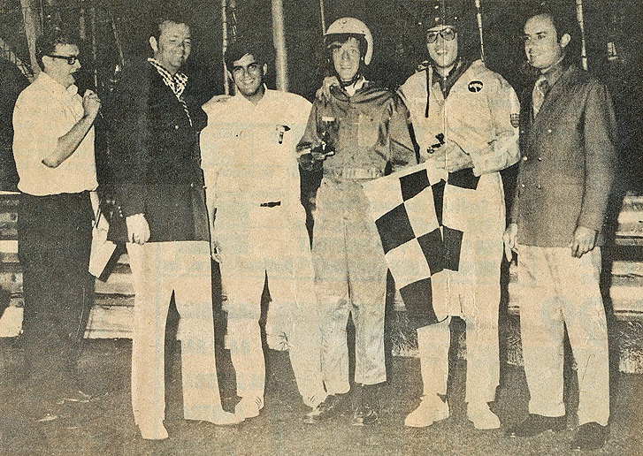 "Radio Announcer Bob DeCarlo from Hartford's WDRC (second from right) won the ""Big D"" special ""Grudge Race"" Saturday night at Stafford Motor Speedway.  Gathered after the race are: Jim Powers, Dick Robinson, Jack ARute, Jr., Dick McDonough, DeCarlo, and Dick Korsen.  (Press photo, Peter Baldracchi)"