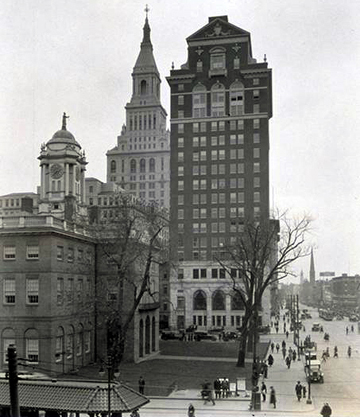 Hartford Trust Company building at 750 Main Street, circa 1936. Traveler's Tower in background, Old Statehouse at middle left. Isle of Safety in Foreground.