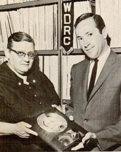 WDRC music director Bertha Porter receives a gold record from Al Khoury of Capitol Records for her efforts in making Al Martino's I Love You Because a national hit (Billboard Magazine, August 3, 1963